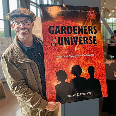 Paul Nylander showing off a poster-sized version of the cover of Gardeners of the Universe